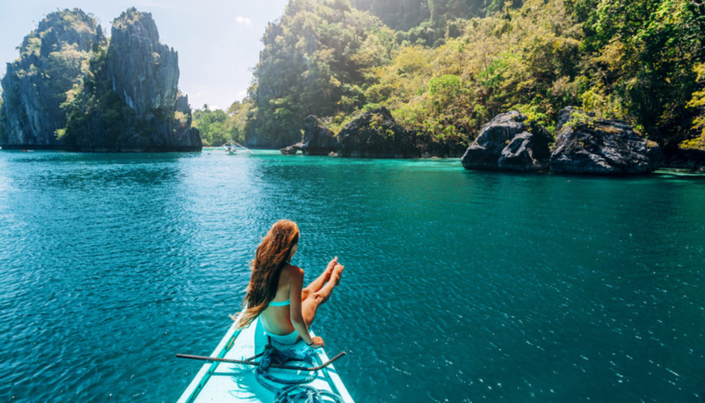 Girl travelling on the boat in Asia